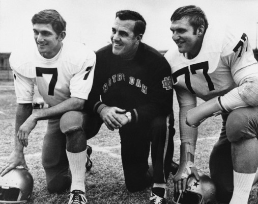 Notre Dame Head Football Coach Ara Parseghian poses with Quarterback Joe Theismann (7) and All-America defense tackle Mike McCoy during picture session on their arrival, Dec. 29, 1969 in Dallas, Texas. The Fighting Irish meets the Texas Longhorns on New Year?s Day in the Cotton Bowl. (AP Photo)